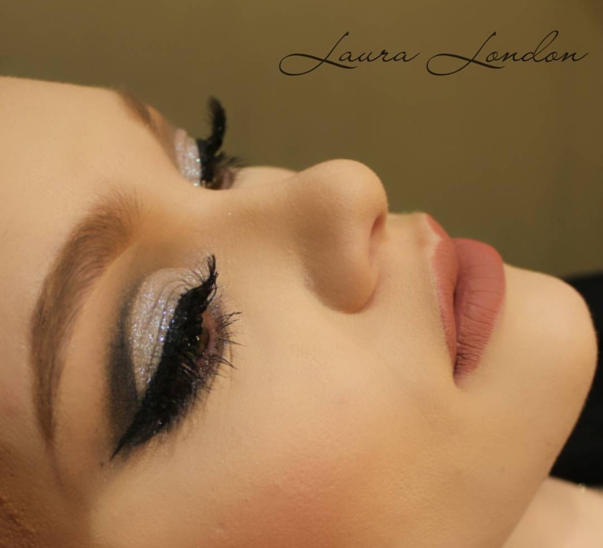 Strip lashes on a client, by Laura London