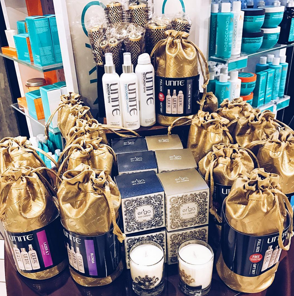 Gift ideas in our salon: candles, hairbrushes, and Unite hair care kits for all hair types.